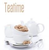 Redskap för teatime och farin som isoleras Royaltyfri Bild