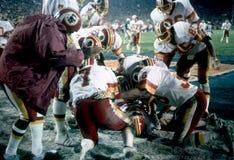 Redskins score in Super Bowl XVII. Joe Theismann and the Washington Redskins celebrate scoring a touchdown against the Miami Dolphins in Super Bowl XVII. (Image royalty free stock photos