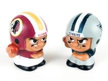Redskins v. Cowboys Li`l Teammates Toy Figures. On a white backdrop royalty free stock photography