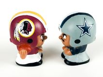 Redskins v. Cowboys Li`l Teammates Toy Figures. On a white backdrop stock photography