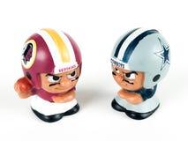 Redskins v. Cowboys Li`l Teammates Toy Figures. On a white backdrop stock photos