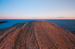 Redsunset rocky coastline Stock Photography