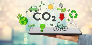 Reduce CO2 with man holding a tablet. Computer Royalty Free Stock Photo