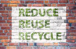 Reduce, reuse, recycle. A flag with the text reduce, reuse, recycle Royalty Free Stock Photos