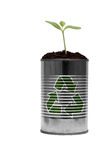 Reduce Reuse and Recycle again. New growth and green shoots come from recycling this simple tin can isolated against white Stock Photos