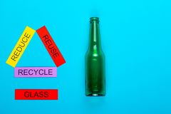 Reduce, Reuse & Recycle. Recycle concept showing reduce, reuse & recycle with glass on a blue background royalty free stock photo