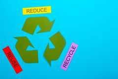 Reduce, Reuse & Recycle. Recycle concept showing the green recycle logo with reduce, reuse, recycle on a blue background stock photos
