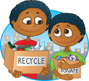 Reduce, reuse, recycle. Ethnic Father and son having fun recycling and donating old toys and clothes Stock Photo