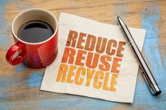 Reduce, reuse, recycle word abstract. Reduce, reuse, recycle  word abstract on a napkin with a cup of coffee - resources conservation concept Stock Photos