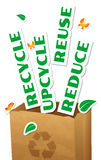 Reduce, Reuse, Upcycle, Recycle. Environmental concept, paper bag with stickers words Reduce, Reuse, Upcycle, Recycle Stock Photo