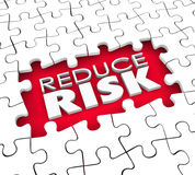 Reduce Risk Puzzle Hole Pieces Lower Danger Increase Safety Secu. Reduce Risk words in the hold of a puzzle with missing pieces to illustrate the need to lower Stock Photo