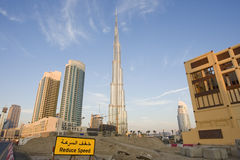 Reduce speed. Picture of burj khalifa in dubai and work done nearby Stock Image