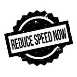 Reduce Speed Now rubber stamp Stock Photography