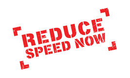 Reduce Speed Now rubber stamp Stock Photo