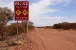 Reduce Speed Road Sign in Outback Australia.. Stock Images