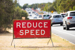 Reduce speed traffic sign warning outdoor Royalty Free Stock Image