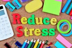 Reduce stress words on cork background Stock Photos