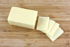 Reduced Fat Cheese Slices Top. Looking down at a block of reduced fat cheese and slices Stock Image