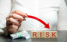 Reduced financial risk for investment and capital. Protection of investment funds and assets. Deposit Insurance. Debt. Restructuring and risk avoidance royalty free stock photos