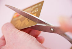Reducing debt: cutting up credit card. royalty free stock images