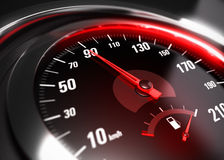 Reducing Speed Safe Driving Concept. Close up of a car speedometer with the needle pointing 90 Km h, blur effect, conceptual image for safe driving concept Stock Images