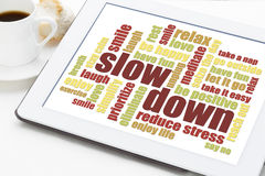 Reducing stress tips. Slow down and relax - reducing stress tips in a form of a word cloud on a digital tablet Royalty Free Stock Photography