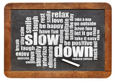Reducing stress tips. Slow down and relax - reducing stress tips in a form of a word cloud on a vintage blackboard royalty free stock photos