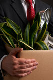 Redundant Businessman Carrying Possessions In Box Stock Photography