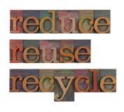 Reduzca, reutilice y recicle - la conservación del recurso Imágenes de archivo libres de regalías