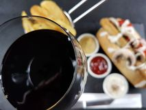 Redwine drink beverage glass wineglass food. Fastfood chips sauces mayonnaise ketchup mustard chicken Royalty Free Stock Image