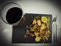 Redwine food chicken pasta lime blackplate. Food delicious elegant eat table beverage drink Royalty Free Stock Photos