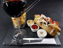 Redwine food frenchfries chicken sauces cutlery plate drink tasty. Blackplate wine meat mayonnaise ketchup mustard Stock Photo