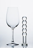 Redwine Glas with Dildo. Huge redwine glass with a glass dildo Stock Images