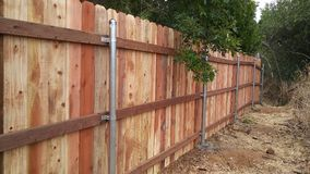 Redwood Fence Background. This is a Redwood fence bordering a backyard Stock Images