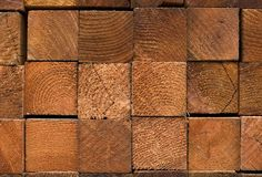Redwood Fence Posts. Closeup image of neatly stacked redwood posts in lumber yard royalty free stock image