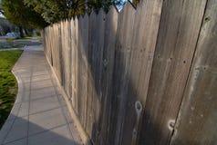 Redwood fence Sidewalk Stock Image