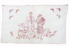 Redwork broderi med en kvinna, en man och en hund Arkivfoton