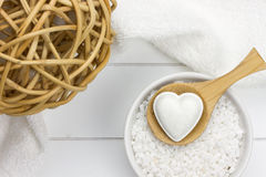 Reed ball, wooden spoon with bath bomb and towel Royalty Free Stock Image