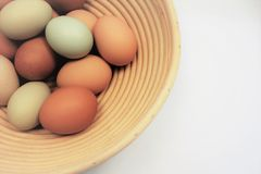 Reed basket with colorful farm fresh eggs Stock Image
