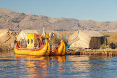 Reed boat on Island of Uros lake Titicaca Peru and Bolivia. Royalty Free Stock Photos