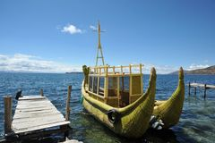 Reed boat to us Mountain Lake Titicaca. TITICACA LAKE, BOLIVIA - SEPTEMBER 4, 2010: Reed boat to us Mountain Lake Titicaca. Indians since ancient times swam on Royalty Free Stock Photos