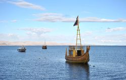 Reed boat to us Mountain Lake Titicaca Stock Photos