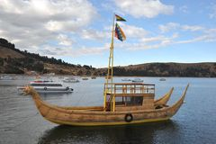 Reed boat to us Mountain Lake Titicaca Stock Photo