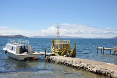 Reed boat to us Mountain Lake Titicaca. Royalty Free Stock Photography