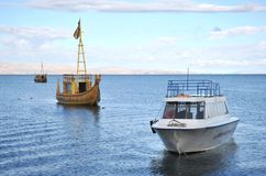 Reed boat to us Mountain Lake Titicaca. Stock Photography