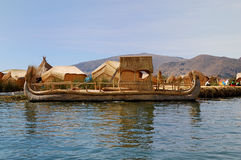 Reed boat of the Uros Islands. Reed boat from a Floating Uros Island on Lake Titicaca in Peru royalty free stock images