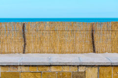 Reed fence beach protection sand wall Royalty Free Stock Photography