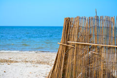 Reed fence by the sea in Sardinia Stock Photography