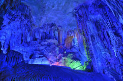 Reed Flute Cave stalactites. Asian China Guangxi Guilin Reed Flute Cave stalactites form under the lamplight royalty free stock photos