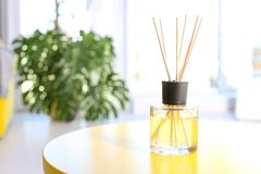 Reed freshener on table in light room. Closeup stock image